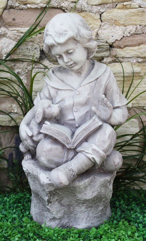 Stone Effect Boy Reading On Stone